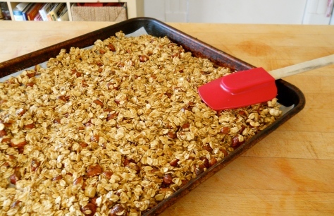 spreading granola in the pan